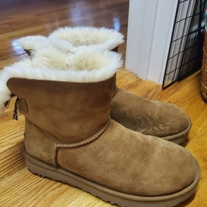 Two ugg booties with bows